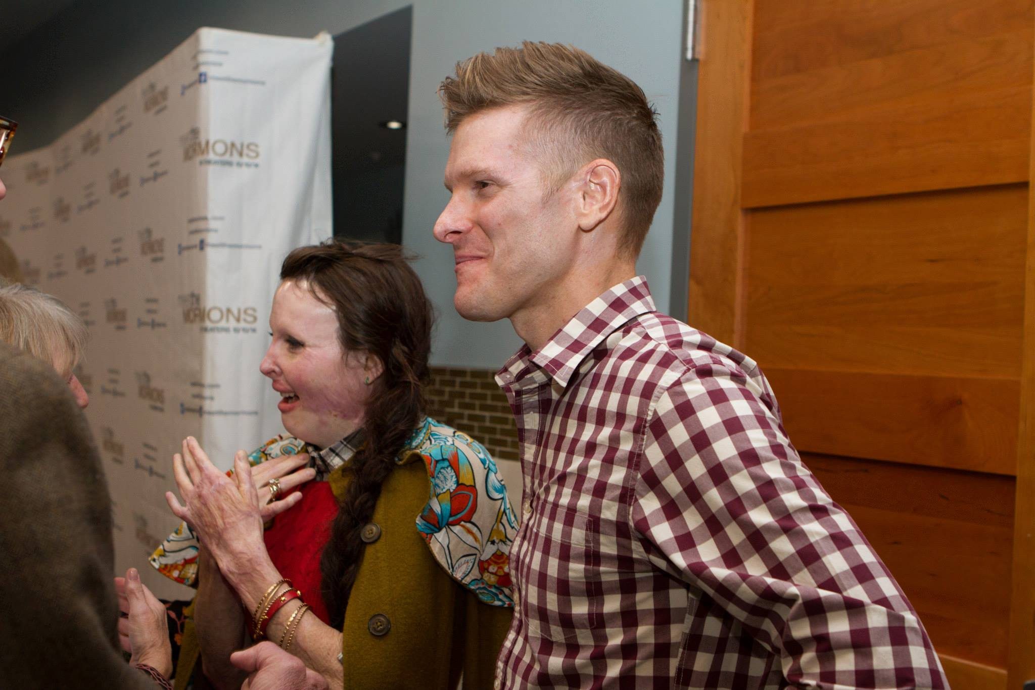 """Stephanie Nielson and her husband, Christian, greet other attendees at the """"Meet the Mormons"""" premiere. Nielson was among many prominent bloggers invited to the event. (John Dye)"""