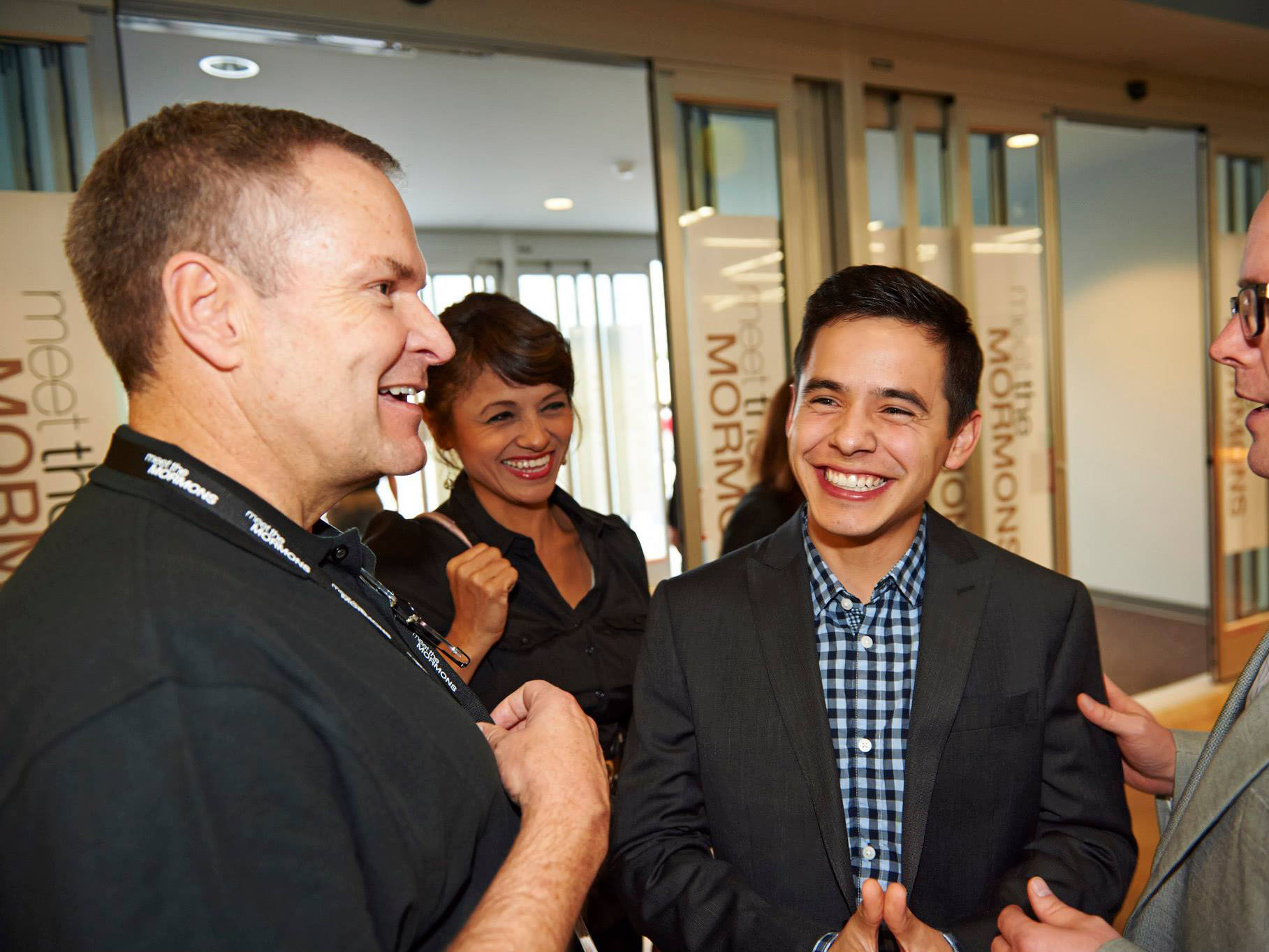 """LDS Public Affairs Senior Manager Scott Trotter visits with David Archuleta behind the scenes at the """"Meet the Mormons"""" premiere. (John Dye)"""