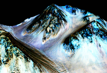 Dark streaks found on Mars inferred to be evidence of a water flow. Photo courtesy of NASA.